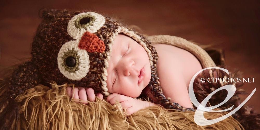 newborn baby boy in owl hat
